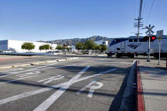 A morning Amtrak train passes northbound by the intersection of Sonora at Air Way in Glendale on Friday morning, February 15, 2013.