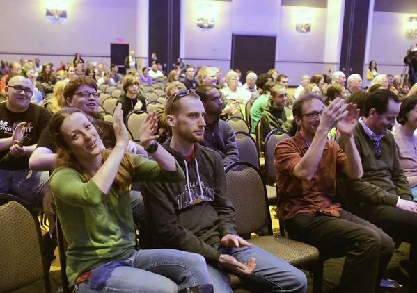 Post doctoral student Addie Dove cheers with others just as the asteroid passes the earth. The public gathered in the Pegasus Ballroom of UCF's Student Union for a viewing party to see an asteroid zoom past Earth in what was supposed to be the closest fly-by in history.