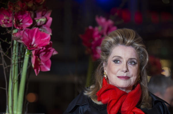 "Actress Catherine Deneuve arrives for the screening of ""On My Way"" at the Berlin International Film Festival."