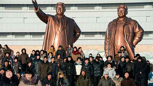 North Korean people visit in front of bronze statues of North Korea founder Kim Il-sung (L) and late leader Kim Jong-il at Mansudae in Pyongyang, in this photo taken by Kyodo February 15, 2013, a day before the birthday of their late leader, Kim Jong-il.