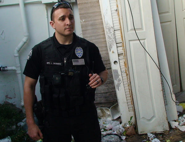 Delray Beach Police Officer Luis Skeberis outside a former drug house on Southeast 3rd Avenue in the Osceola Park neighborhood. Police worked with code enforcement and the property owner to have the dealers evicted.