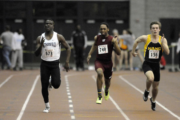 Wethersfield's O'Neill Drummond, left, eyes opponents - Windsor's Tikuan Johnson (center) and Hand's Hugh Whelan - in the boys 55 meter dash final at the Class L indoor track championships at the New Haven Athletic Center Friday. Drummond won with a time of 6.48 seconds, the fastest time in the state this season. Whelan was third in 6.60 and Johnson was fourth in 6.62.