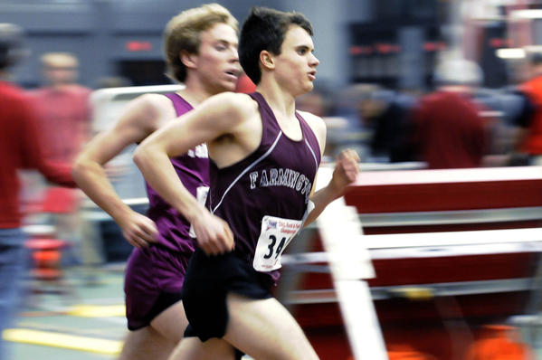 Farmington's Matt Chisholm runs in the boys 1,600 meters at the Class L indoor track championships at the New Haven Athletic Center. Chisholm came in first with a time of 4:26.18.