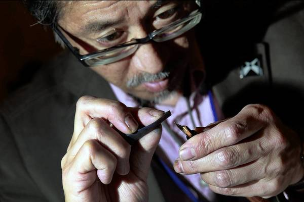 Motoshi Kazuno, a pen maker and woodworker who lives outside Tokyo, refines the nib on a fountain pen at the 25th Los Angeles International Pen Show in Manhattan Beach.
