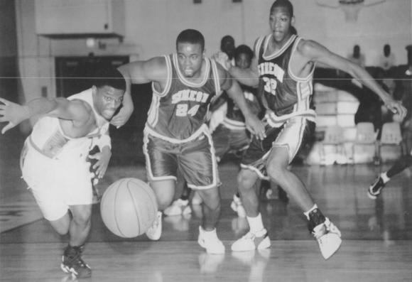 Carver's Lamin Johnson (left) goes for the basketball along with Simeon's Dante Culbreath (24) and Bobby Simmons in January 1997.