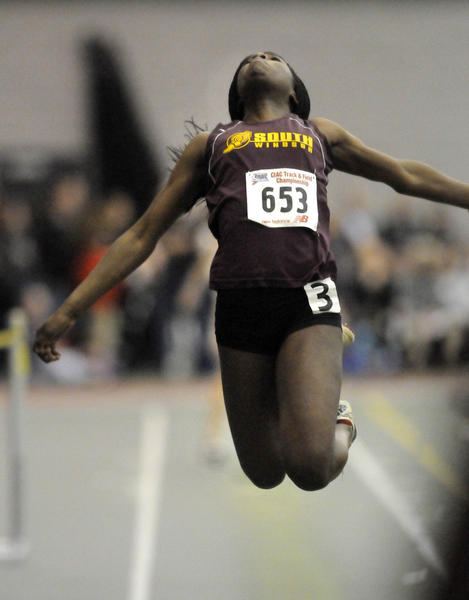 South Windsor's Michele Otaluka competes in the long jump at the Class L indoor track championships at the New Haven Athletic Center.