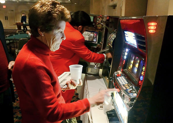 Lillie Stenger of Williamsport tries her luck at a slot machine during the Discovery Station's Sweetheart Casino Big Band Evening held at Hager Hall.