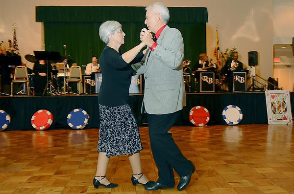 Sandi and Tom Miguel of Hagerstown dance to the music of Ray Birely's Big Band at the Discovery Station's Sweetheart Casino Big Band Evening held at Hager Hall.
