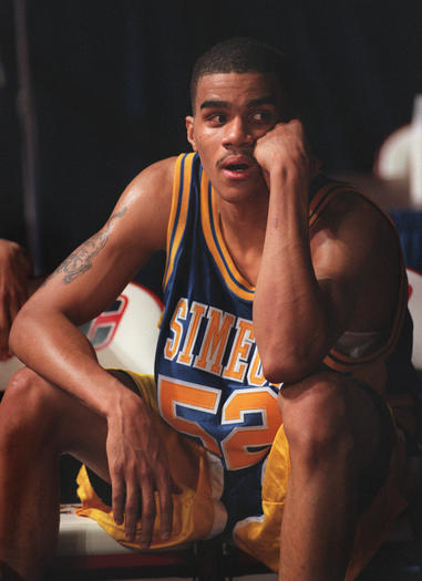 Simeon's Cameron Echols watches from the bench during a 1999 game against Lincoln Park