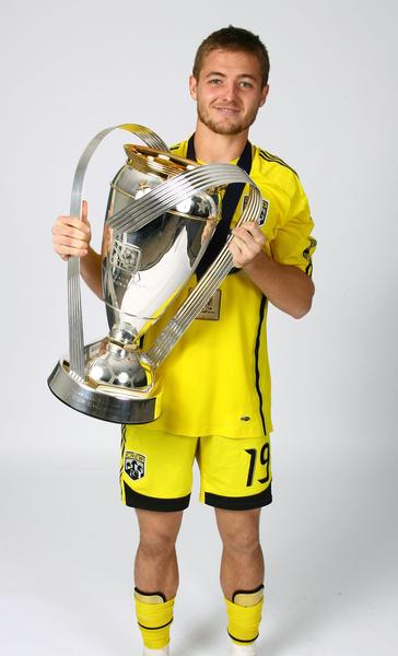 Robbie Rogers poses for a postgame celebration portrait with the Philip F. Anschutz trophy after the Crew beat the Red Bulls 3-1 to win the 2008 MLS Cup.