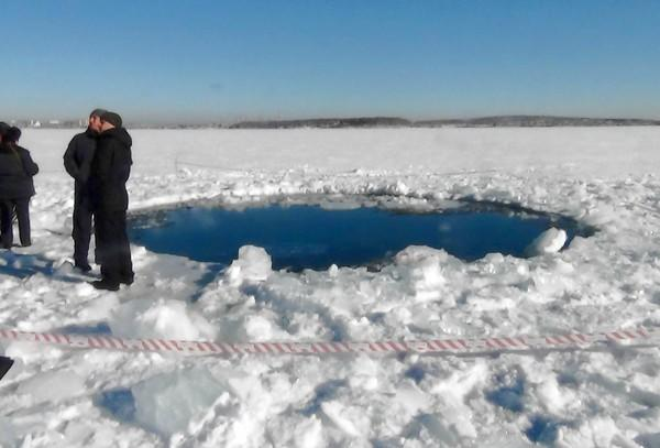 The biggest piece of the space rock that broke apart over Russia to make it to the ground is believed to have made this gaping hole in Chebarkul Lake about 60 miles west of Chelyabinsk, according to a Russian government news television network.