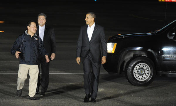 President Barack Obama walks on the tarmac at Palm Beach International Airport Friday evening to greet local constituents. The president is reported to be traveling to a resort in Palm Bay near Stuart for a break for the weekend. 2/15/12. Jim Rassol, Sun Sentinel.