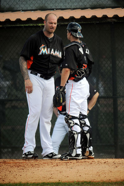Miami Marlins  pitcher Jon Rauch talks with catcher Rob Brantly after a pitching session Tuesday  during spring training in Jupiter.