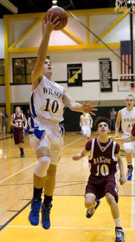 Wilson's Ryan Dailey (10) drives to the basket past Bangor's Michael Martino (10) during their Colonial League Championship game at Freedom High School on Friday night.