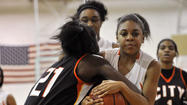 Dyzhanay Burton and her City girls basketball teammates exacted their revenge against Poly on Friday night and finally eased the sting of losing last year's Baltimore City championship to their archrival.