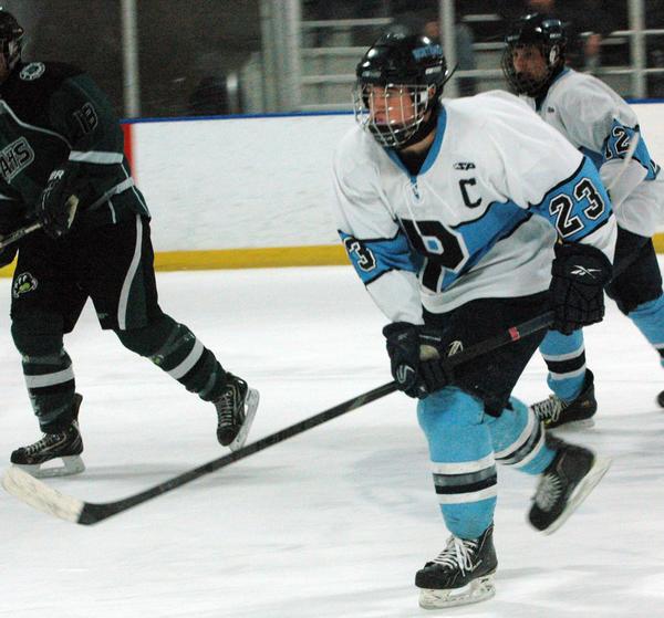 Petoskey senior forward Skye Pieffer follows the play during Friday's Big North Conference against Alpena at Griffin Arena. Pieffer had a goal and an assist as the Northmen fell to the Wildcats, 5-4, in overtime.
