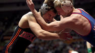 George Fisher of Marmion wrestles Doug Johnson of DeKalb in the state wrestling finals.
