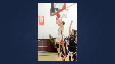 Rockwood senior Luke Miller fights his way to the backboard in home win against Turkeyfoot on Friday.