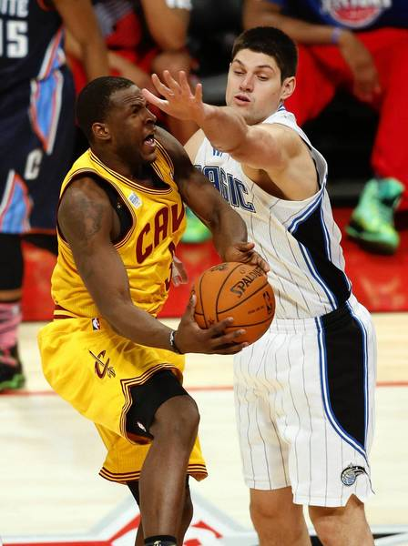 Team Shaq guard Dion Waiters (3) of the Cleveland Cavaliers shoots against Team Chuck center Nikola Vucevic (9) of the Orlando Magic during the second half of the rising stars challenge during the 2013 NBA All-Star weekend at the Toyota Center.