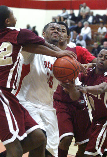 Pasadena's Brandon Jolley drives down the middle of the lane through most of the Downey defense for a layup and a foul in the first round of the CIF Southern Section Division 1-AA playoffs at Pasadena High School on Friday, February 15, 2013.