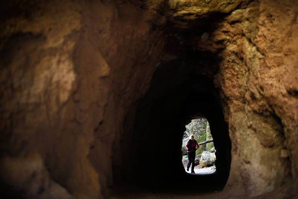 Bernadette Carter, 49, of Hollister, Calif., walks through a man-made tunnel at the new Pinnacles National Park. Officials of the nearby town of Soledad, which sits outside the park's west entrance, hope park tourists will also come their way.