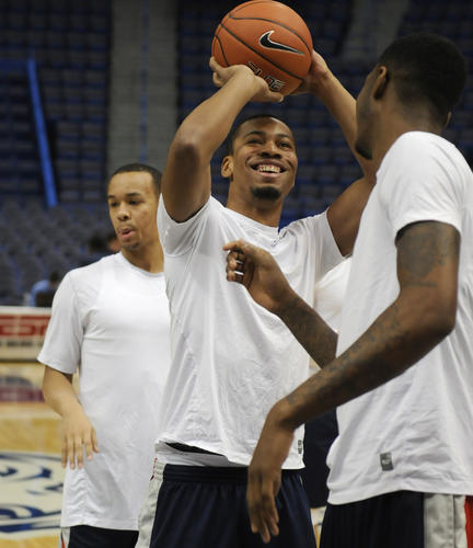 Omar Calhoun, center, warms up with his teammates before UConn plays Villanove at XL Center in Hartford Saturday.
