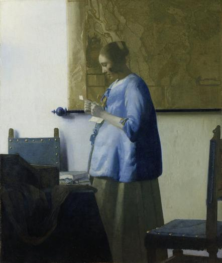 'Woman in Blue Reading a Letter'