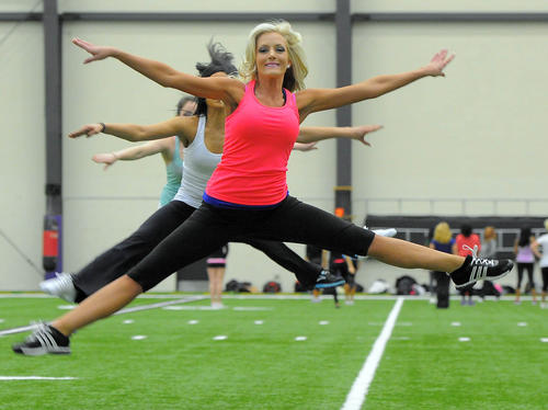 Emily Hair, 25, Odenton, takes part in the prep clinic the 2012 Baltimore Ravens Cheerleaders and coaching staff hold at their training ground. Hair tried out last year and will do it again in March.