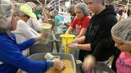 Numana, Volunteer Kansas, and KWCH teamed up Saturday afternoon to help feed hungry kids in Haiti. Hundreds of people filled the Kansas Colliseum to pack beans and rice into bags as fast as they could, hoping to break a world record.