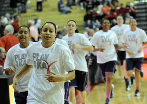 UConn's Bria Hartley leads her team onto the court before the game against Rutgers at the RAC Saturday afternoon.