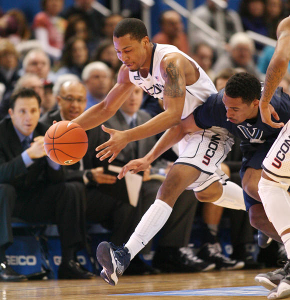 UConn guard Omar Calhoun chases down a loose ball ahead of Villanova guard Brendan Allen in the first half Saturday afternoon. Calhoun led the Huskies with 16 points and six rebounds.