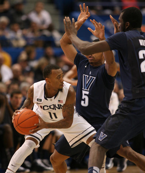 UConn's Ryan Boatright looks for help while being double teamed by Villanova guard Tony Chennault and forward Daniel Ochefu in the 1st half at the XL Center in Hartford Saturday. UConn lost 61-70. Boatright scored 4 points in the loss.