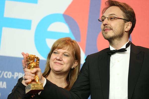 "Director Calin Peter Netzer, right, and producer Ada Solomon pose with the Golden Bear award for Best Film for his ""Child's Pose"" during a press conference after the closing ceremony of the 63rd annual Berlin International Film Festival."