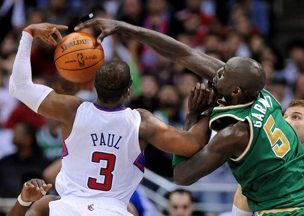 Clippers point guard Chris Paul and Celtics power forward Kevin Garnett battle for a rebound during a game last season at Staples Center.