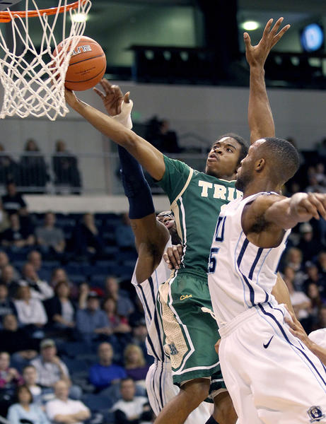 Marcus Thornton of William & Mary gets the layup past Donte Hill of Old Dominion during the first half Saturday in Norfolk.