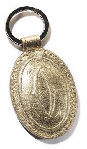 """Cartier, 630 N. Michigan Ave., must de Cartier gold leather key ring, $135, <a href=""""http://cartier.com"""">cartier.com</a>"""