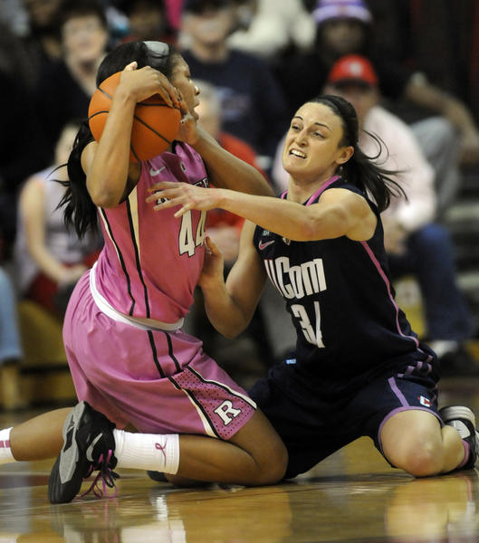 UConn's Kelly Faris plays tough defense in the second half, fighting for a loose ball with Rutgers' Betnijah Laney. The UConn women beat Rutgers at the RAC Saturday afternoon, 65-45.