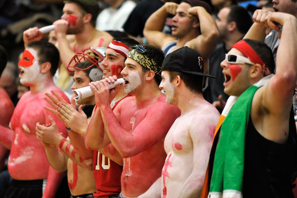 Muhlenberg students cheer on the mens team. The Muhlenberg College Mules mens basketball team played against the Ursinus College Bears Saturday, February 16th, 2013 at Memorial Hall on the campus of Muhlenberg College in Allentown.
