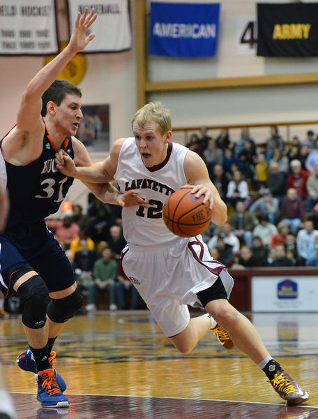 Lafayette's Seth Hinrichs (12) dribbles against Bucknell's Mike Muscala (31) during a men's basketball game at Lafayette College's Kirby Sports Center in Easton on Saturday.