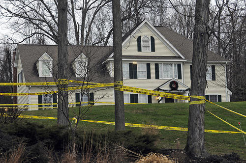 Police tape surround the area near the home of Nancy Lanza, the mother of Adam Lanza, as detectives search for clues in the Sandy Hook Elementary School shooting.