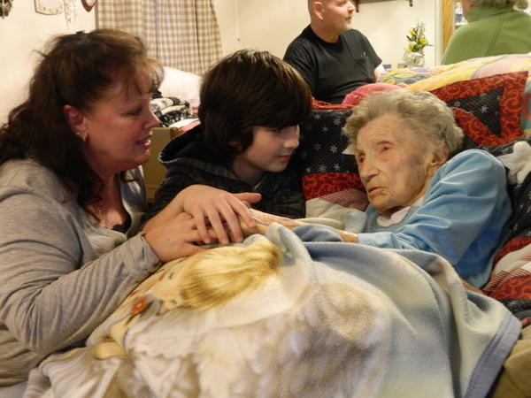 Ida Kate Grimes, 108, of Hagerstown, right, celebrates her birthday Saturday with caregiver Marianne Cline and Cooper Cline, 10, at her West End home.