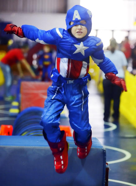 Weston Mower, 7, of Waynesboro, dressed like Captain America as he maneuvered through an obstacle course during the 2013 Super Hero Party at HCC's Athletic, Recreation and Community Center Saturday.