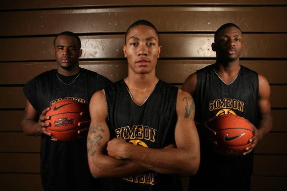 From left: Simeon's Tim Flowers, Derrick Rose, and Kevin Johnson pose before the 2006-2007 season.