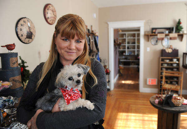 Karin McIntyre, of Orefield, holds her 4- year old Morky, Riley, in her store, GingerBread House Gifts & Antiques, in Trexlertown.