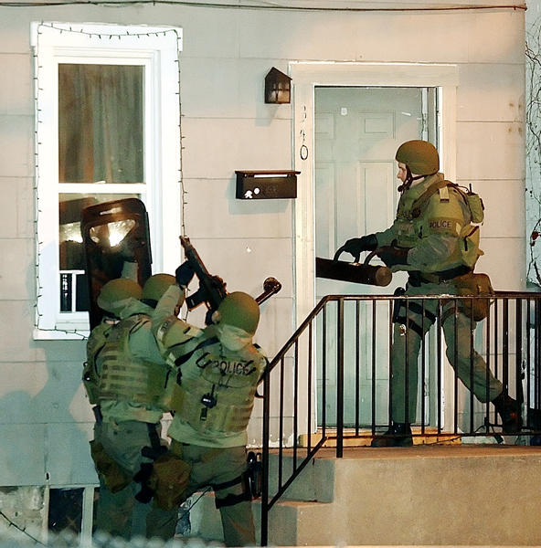 Washington Co. Special Response Team use a ramming device to force the door open at 340 N. Jonathan St. Saturday.