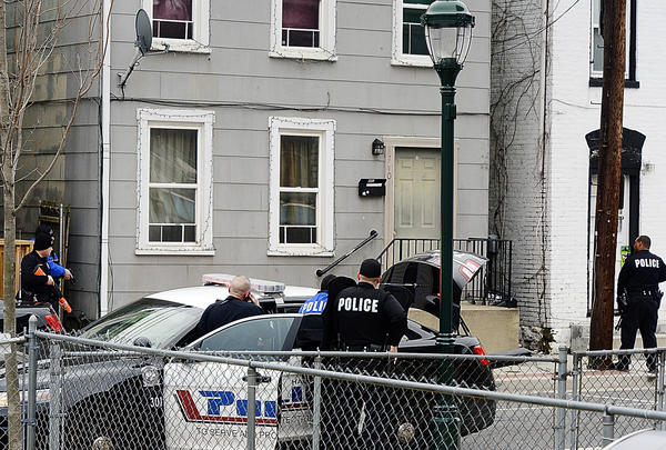 Hagerstown City Police surround a house at 340 N. Jonathan St. Saturday.  The suspect surrendered after a nearly three-hour standoff.