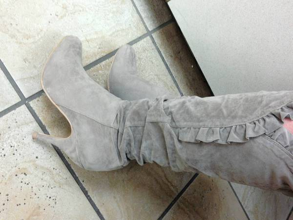 "Melanie Mingee, of Hampton, bought this pair of boots for $20 through a Facebook ""Trash and Treasure"" group. She says she ""aboslutely thinks"" she gets better deals through the site."