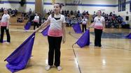 Sporting purple ribbons in memory of one of their teachers, Western Heights Middle School's indoor guard took the floor Saturday at Greencastle-Antrim High School 25th annual guard competition.