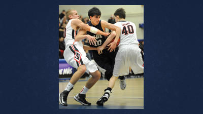 Shade's Ryan Fyock battles CT's Dillon Boyer (left) and Jeremy Sotosky for the ball Saturday.