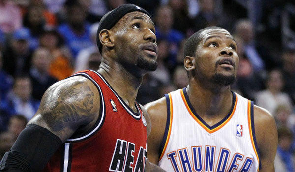 LeBron James, left, and the Miami Heat defeated Kevin Durant and the Oklahoma City Thunder, 110-100, Thursday night.